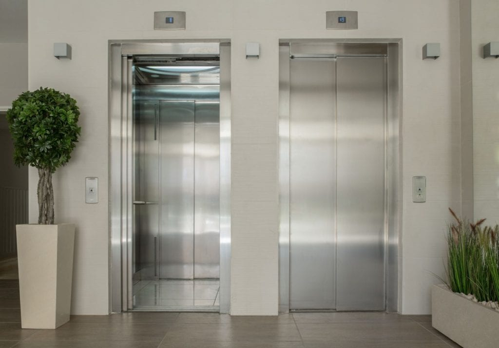 elevator-cab-interiors-hall-frame-door-recladding